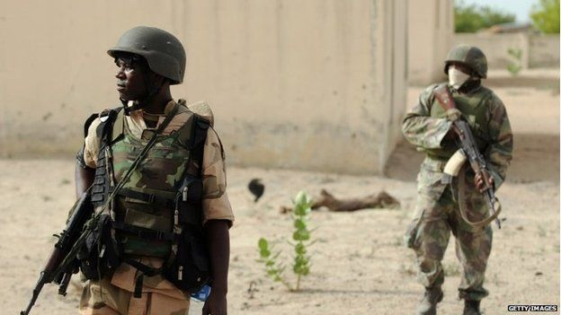 Nigerian soldiers patrol in the north of Borno state close to a Islamist extremist group Boko Haram former camp on 5 June 2013