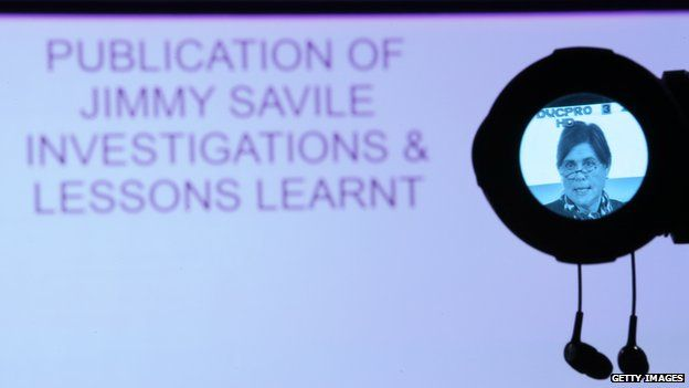 """screen saying: """"Jimmy Savile investigations & lessons learnt"""" plus Kate Lampard in camera viewfinder"""