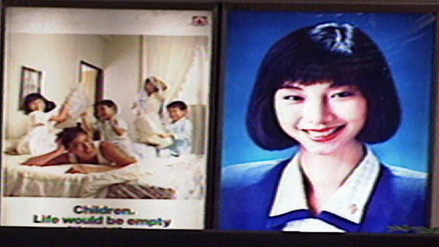 A poster in a shopping mall exhorts Singaporeans to have more children