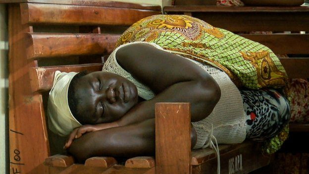 A patient waiting to be seen sleeps in Ghana