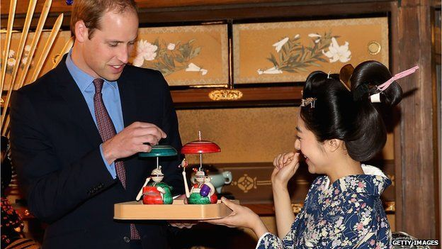 Prince William is given a gift by an actress