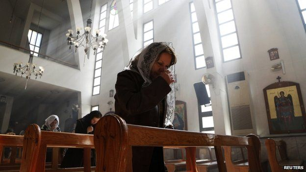 An Assyrian woman attends a mass in Damascus in solidarity with the Assyrians Christians abducted by Islamic State fighters in Syria (01 March 2015)