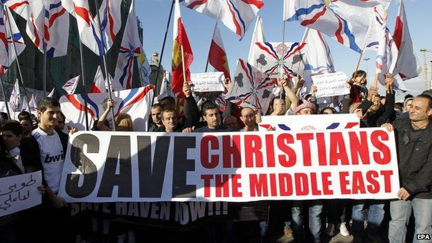 Assyrian Christians, who have fled the unrest in Syria and Iraq, hold a banner as they protest in front the UN house in Beirut (28 February 2015)