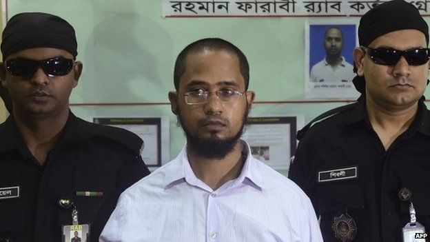 Farabi Shafiur Rahman (C), arrested over the machete murder of an atheist American blogger, during a photocall in Dhaka on March 2, 2015.