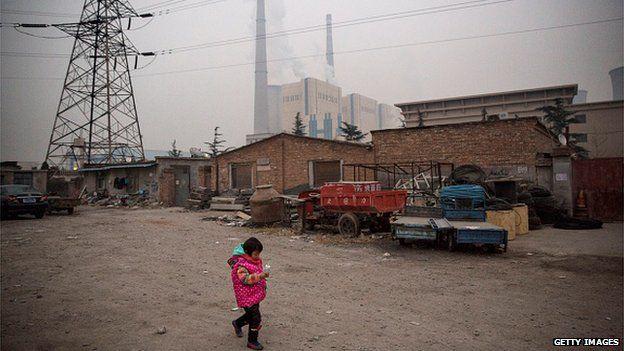Child near a power station in Beijing, China (Nov 2014)