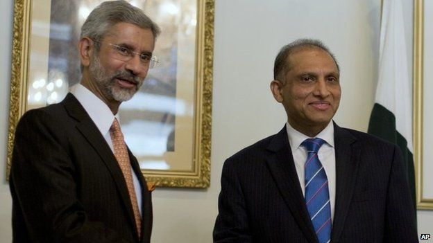 Indian Foreign Secretary Subrahmanyan Jaishankar, left, poses for photographers, as he shakes hands with his Pakistani counterpart Aizaz Chaudhry at the foreign ministry in Islamabad, Pakistan, Tuesday, March 3, 2015