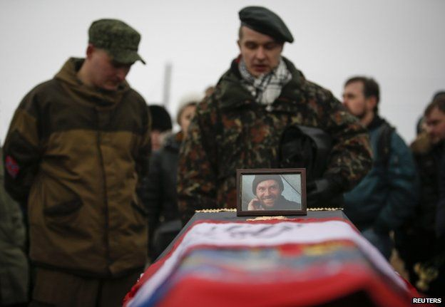 Mourners at the funeral in St Petersburg, Russia, of a Russian teacher killed in Donetsk fighting for the Ukrainian rebels