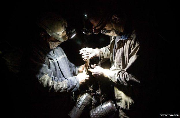 Coal miners work below the surface of the earth at Scheglovka Glubokaya mine in Makiivka, eastern Ukraine, 3 March