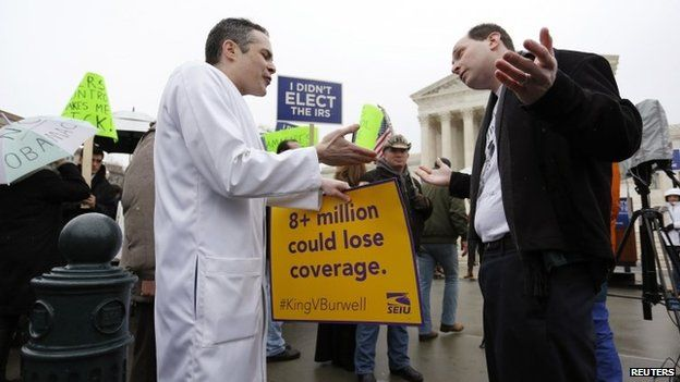 Devon Fagel (L), a physician and cancer survivor, argues in favour of Obamacare with Phil Kerpen (R), who was part of a Tea Party Patriots demonstration against the health care law, in front of the Supreme Court building in Washington 4 March 2015