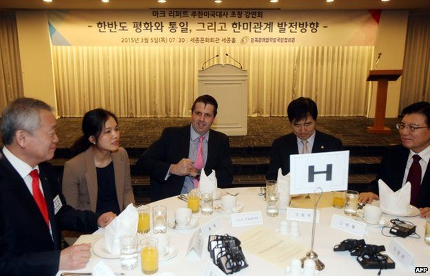 Mark Lippert at the table just before the attack in Seoul, 5 March