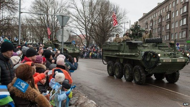 A tank with an US flag takes part in a military parade to celebrate Estonia's independence anniversary in Narva. Photo: 24 February 2015