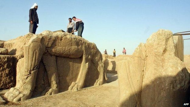 Iraqi workers clean a statue at an archaeological site in Nimrud, 35km (22 miles) southeast of Mosul, northern Iraq, in 2001