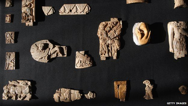 Some of a collection of 6,000 pieces of carved ivory known as the Nimrud Ivories discovered in the city of Nimrud in modern day Iraq but acquired by the British Museum are displayed in 2011 in London, the UK