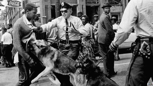 Dog attacks civil rights demonstrator in Birmingham Alabama in 1963
