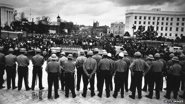 A line of policemen on duty during a black voting rights march in Montgomery, Alabama - 30 MArch 1965