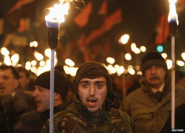 Demonstrators from Svoboda and Right Sector mark the 106th anniversary of the death of Stepan Bandera on 1 January 2015