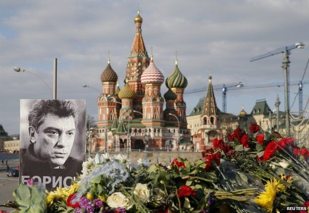 A poster of Boris Nemtsov and flowers at the spot where he was shot in Moscow, 6 March