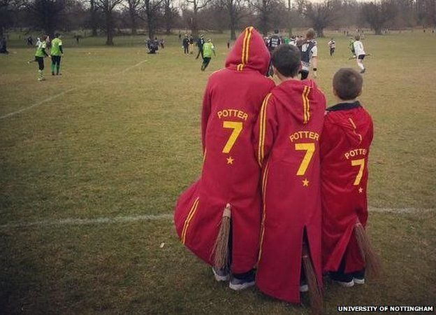 Harry Potter fans watch the quidditch players at Wollaton Park