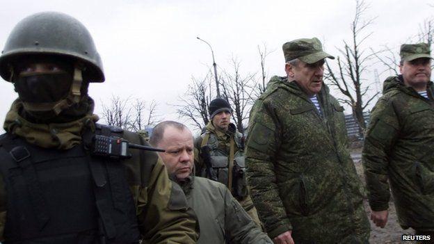 Russian Lieutenant General Alexander Lentsov arrives to visit the airport in Donetsk