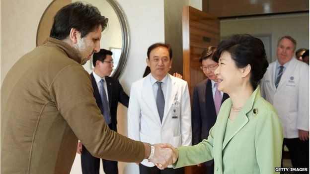 In this handout image provided by the South Korean Presidential House, South Korean President Park Geun-hye shakes hands with U.S. Ambassador to South Korea Mark Lippert at Severance Hospital on 9 March 2015 in Seoul, South Korea