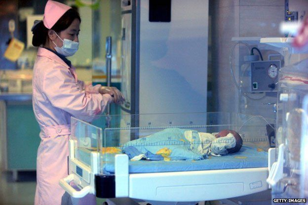 December 18, 2012 shows a nurse looking after a rescued baby in a hospital in Xichang, southwest China's Sichuan province