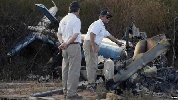 Members of the joint investigation of civil aviation accidents inspect the wreckage of the helicopter which collided mid-air near Villa Castelli on 10 March, 2015