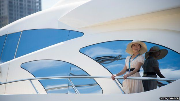 Chinese woman on yacht