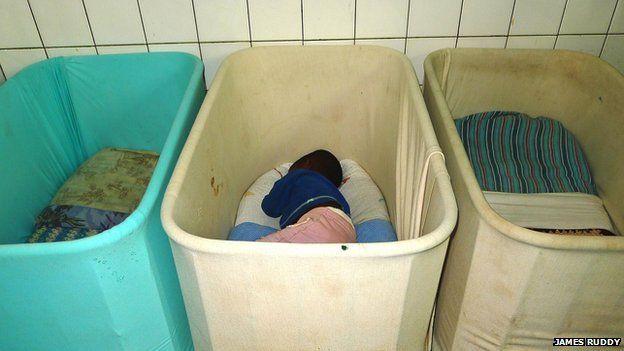 A child in a cot in Noel Orphanage in Rwanda