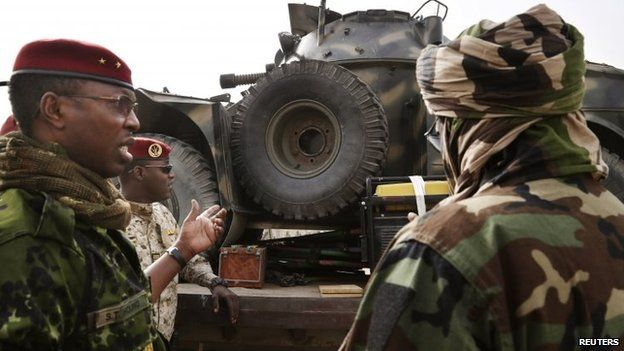 A Chadian military general inspects an armoured vehicle, which the Chadian military say was taken by them from insurgent group Boko Haram in Nigeria - 26 February 2015