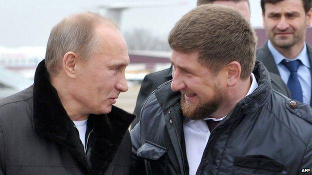 Russia's Prime Minister Vladimir Putin (L) speaks with Chechnya's leader Ramzan Kadyrov in Gudermes on 20 December 2011