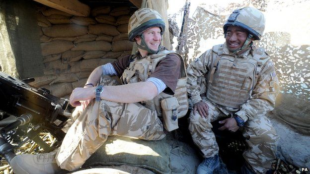 Prince Harry talks to a Gurkha soldier at the observation post at JTAC Hill in Helmand province