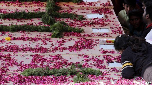 Coffins for some of the victims of Sunday's suicide bombings in Lahore