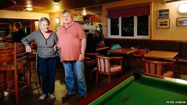 Mary and Alistair Johnston pictured in the Am Politician pub, Eriskay
