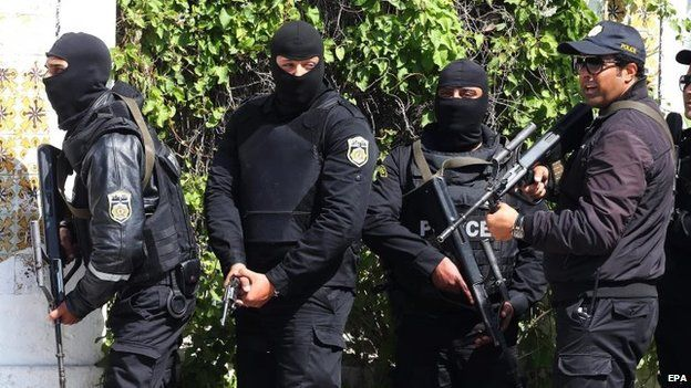 Members of the Tunisian security services take up positions after gunmen reportedly took hostages near the country's parliament, outside the National Bardo Museum, Tunis, Tunisia, 18 March 2015