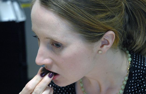 Alexandra Dimsdale tastes a piece of chocolate