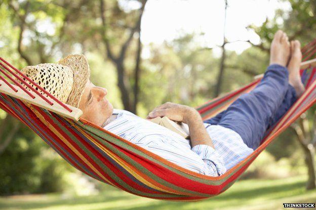 Man asleep in a hammock