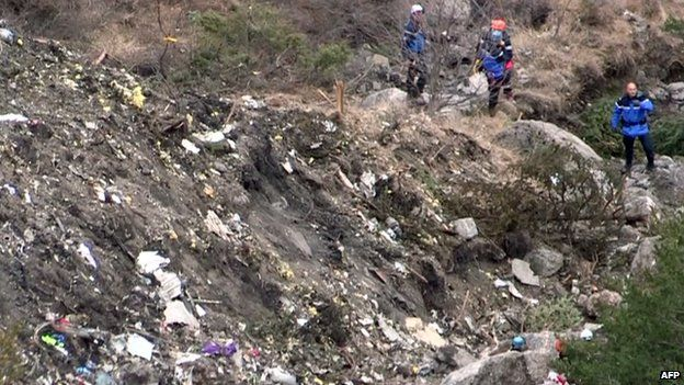 Recovery workers at crash site