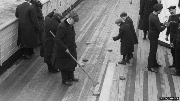 Saloon passengers enjoy a game of shuffleboard on the deck