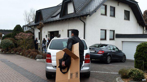 Investigators outside co-pilot's house