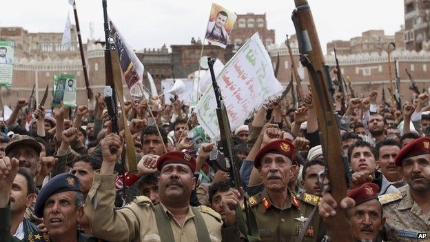 Shiite rebels, known as Houthis, hold up their weapons to protest against Saudi-led airstrikes, during a rally in Sanaa, Yemen on 26 March, 2015