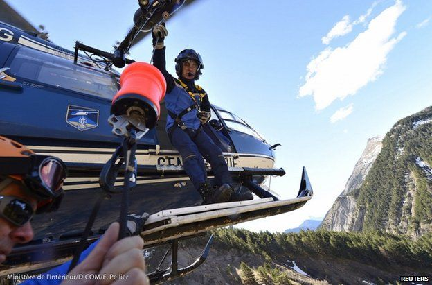 French police on a helicopter near the crash site, 27 March