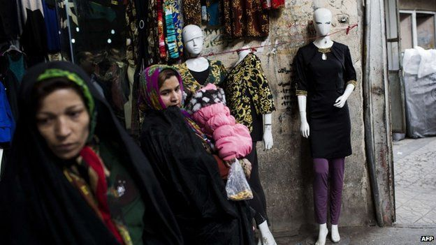 "Iranian women wander as they shop at Tehran""s grand bazaar"