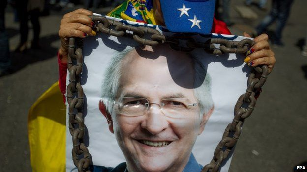 A woman holds up a poster with a picture of Mr Ledezma at a protest in Caracas on 20 February 2015.