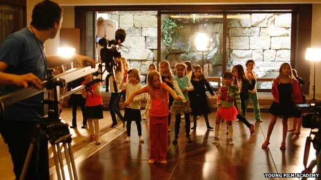 Children at a movie making party