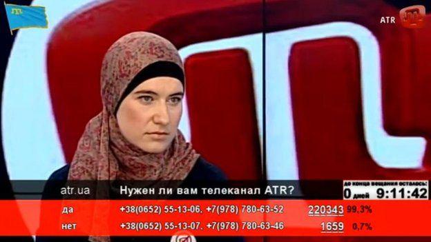 Presenter wearing a headscarf