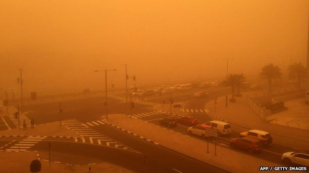 Cars are seen driving amid a sandstorm that engulfed the city of Dubai on 02 April 2015.