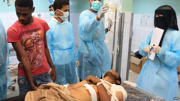 A Yemeni man receives treatment at a hospital in the southern city of Aden on April 2, 2015