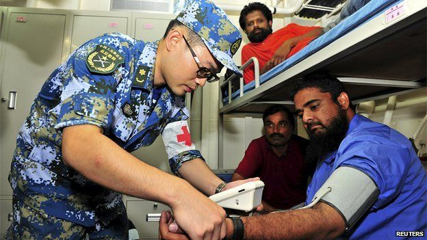 Chinese medical check aboard evacuation ship, 2 Apr 15