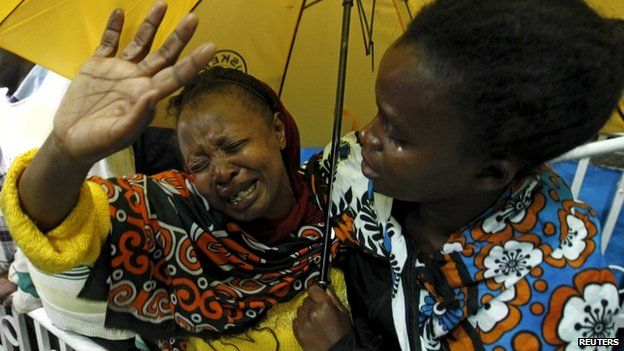 """A woman reacts after seeing her son who was rescued from the Garissa University attack in Kenya""""s capital Nairobi 4 April 2015"""