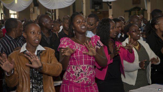 Kenyan Christians sing during a morning service at Holy Family Basilica, Nairobi, Kenya on 5 April, 2015